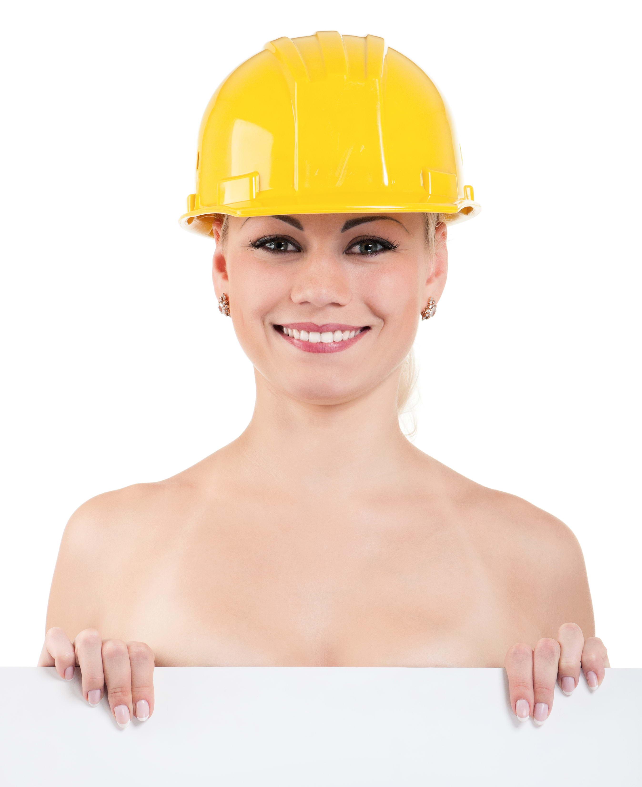девушка строитель в каске, голая, стоит