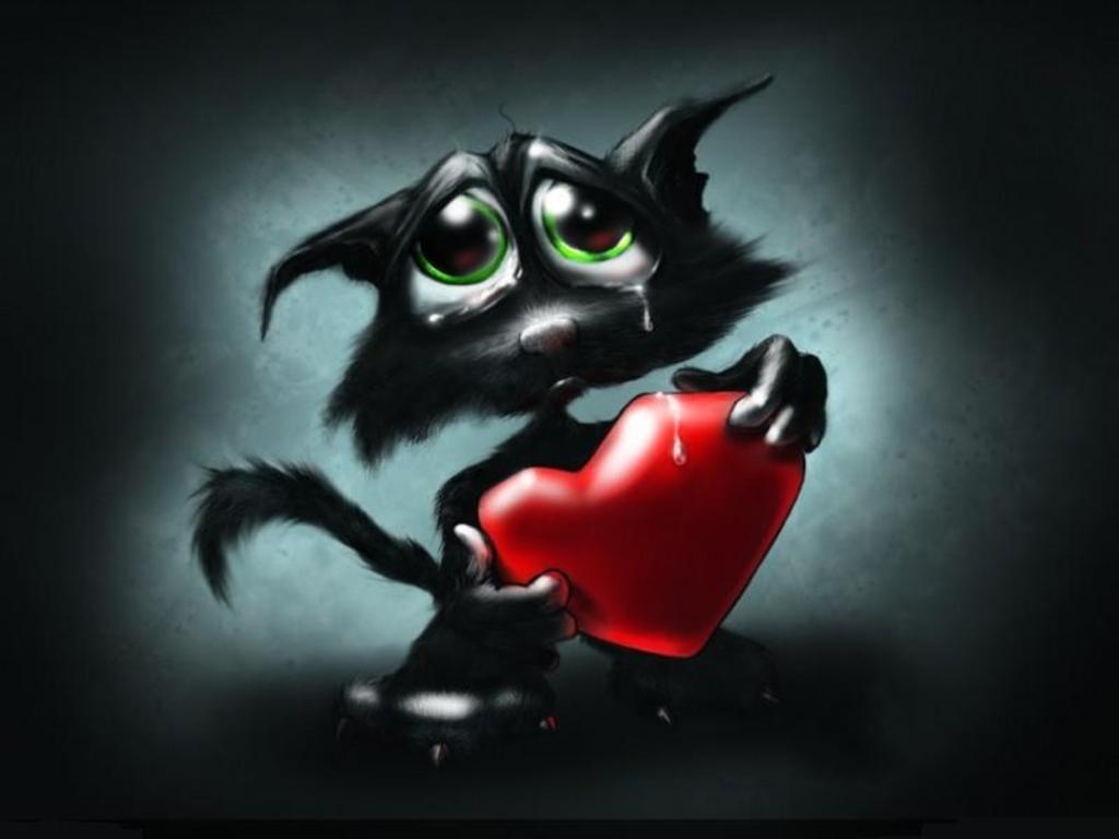 черный котенок с сердцем в лапах плачет, фото